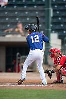 Missoula Osprey shortstop Brandon Leyton (12) at bat in front of catcher Griffin Barnes (28) during a Pioneer League game against the Orem Owlz at Ogren Park Allegiance Field on August 19, 2018 in Missoula, Montana. The Missoula Osprey defeated the Orem Owlz by a score of 8-0. (Zachary Lucy/Four Seam Images)