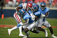 Ole Miss defenders block Arkansas running back Trelon Smith (22), Saturday, October 9, 2021 during the fourth quarter of a football game at Vaught Hemingway Stadium in Oxford, Miss. Check out nwaonline.com/211010Daily/ for today's photo gallery. <br /> (NWA Democrat-Gazette/Charlie Kaijo)