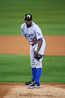 Glendale Desert Dogs pitcher Jharel Cotton (37) looks in for the sign during an Arizona Fall League game against the Salt River Rafters on October 22, 2015 at Salt River Fields at Talking Stick in Scottsdale, Arizona.  Glendale defeated Salt River 7-5.  (Mike Janes/Four Seam Images)