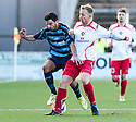 Forfar's Omar Kader holds off Stranraer's Chris Aitken.