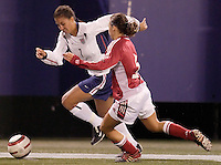 """USA's Shannon Boxx looks to get past Bettina Falk of Denmark. The US Women's National Team tied the Denmark Women's National Team 1 to 1 during game 8 of the 10 game the """"Fan Celebration Tour"""" at Giant's Stadium, East Rutherford, NJ, on Wednesday, November 3, 2004.."""