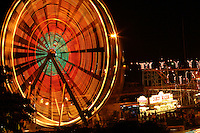 Long-exposure photo of Ferris wheel at the 50th State Fair held yearly on Oahu, Hawaii at the Aloha Stadium parking lot.