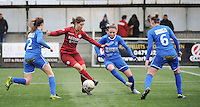 20160206 - Zulte , BELGIUM : Zulte Waregem's Athina Vercaemer (Red) with Genk's Fien Steyvers (L) and Sharon Lemmens (M) and Riete Loos (6) pictured during the soccer match between the women teams of Zulte Waregem and Ladies Genk , in the quartel final matchday of the Belgian CUP - Beker van Belgie voor Vrouwen competition on Saturday 6th February 2016 in Zulte .  PHOTO SPORTPIX.BE DIRK VUYLSTEKE