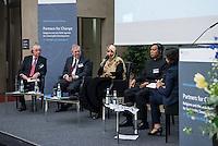 """BMZ-Konferenz """"Religion und die Agenda 2030 fuer nachhaltige Entwicklung"""".<br /> Vlnr: Prof. Dr. Klaus Toepfer, Bundesumweltminister a. D., ehem. Direktor des UN-Umweltschutzprogramms UNEP; Eric G. Postel, Associate Administrator, U.S. Agency for International Development (USAID), USA; Tawakkol Karman, Friedensnobelpreistraegerin (2011), Jemen; Erzb. Sebastian Francis Shaw OFM, Erzbischof von Lahore, Pakistan.<br /> 17.2.2016, Berlin<br /> Copyright: Christian-Ditsch.de<br /> [Inhaltsveraendernde Manipulation des Fotos nur nach ausdruecklicher Genehmigung des Fotografen. Vereinbarungen ueber Abtretung von Persoenlichkeitsrechten/Model Release der abgebildeten Person/Personen liegen nicht vor. NO MODEL RELEASE! Nur fuer Redaktionelle Zwecke. Don't publish without copyright Christian-Ditsch.de, Veroeffentlichung nur mit Fotografennennung, sowie gegen Honorar, MwSt. und Beleg. Konto: I N G - D i B a, IBAN DE58500105175400192269, BIC INGDDEFFXXX, Kontakt: post@christian-ditsch.de<br /> Bei der Bearbeitung der Dateiinformationen darf die Urheberkennzeichnung in den EXIF- und  IPTC-Daten nicht entfernt werden, diese sind in digitalen Medien nach §95c UrhG rechtlich geschuetzt. Der Urhebervermerk wird gemaess §13 UrhG verlangt.]"""