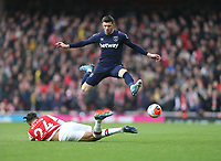 West Ham United's Aaron Cresswell evades the challenge of Arsenal's Reiss Nelson<br /> <br /> Photographer Rob Newell/CameraSport<br /> <br /> The Premier League - Arsenal v West Ham United - Saturday 7th March 2020 - The Emirates Stadium - London<br /> <br /> World Copyright © 2020 CameraSport. All rights reserved. 43 Linden Ave. Countesthorpe. Leicester. England. LE8 5PG - Tel: +44 (0) 116 277 4147 - admin@camerasport.com - www.camerasport.com