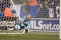 MVP Matt Reis (NE Revolution, blue) saves a penalty kick at the end of regulation play. NE Revolution advance to Eastern Conference Finals with a 4-2  penalty kicks victory over Chicago Fire after a 2-2 aggregate tie, at Gillette Stadium.
