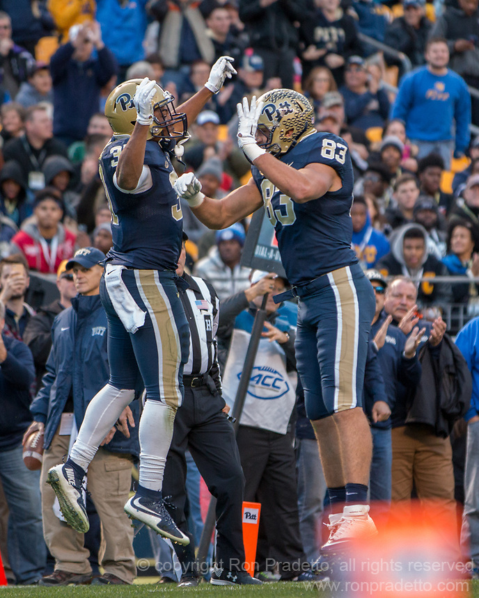 Pitt running back Qadree Ollison (left) and tight end Scott Orndoff (83) celebrate Ollison's one-yard touchdown run. The Pitt Panthers football team defeated the Louisville Cardinals 45-34 on Saturday, November 21, 2015 at Heinz Field, Pittsburgh, Pennsylvania.