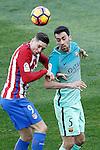 Atletico de Madrid's Fernando Torres (l) and FC Barcelona's Sergio Busquets during La Liga match. February 26,2017. (ALTERPHOTOS/Acero)