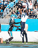 CHARLOTTE, NC - DECEMBER 15: D.K. Metcalf #14 of the Seattle Seahawks catches a touchdown pass over Donte Jackson #26 of the Carolina Panthers during a game between Seattle Seahawks and Carolina Panthers at Bank of America Stadium on December 15, 2019 in Charlotte, North Carolina.