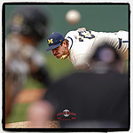 Steve Hajjar (27) of the Michigan Wolverines, Baseball America's No. 34 prospect in the 2021 draft class, delivers a pitch in a game against the Purdue Boilermakers on Friday, March 12, 2021, at Fluor Field at the West End in Greenville, South Carolina. Michigan won, 9-1, and Hajjar earned his first win of the season. (Tom Priddy/Four Seam Images)
