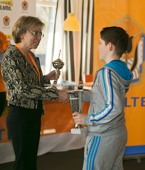 Rotterdam, The Netherlands, 07.03.2014. NOJK ,National Indoor Juniors Championships of 2014, 12and 16 years, Winner boys 12 years Jens Hoogendam (NED) receives the trophy out of the hands of Petra Hermans.<br /> Photo:Tennisimages/Henk Koster