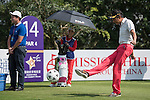 Wu Zhoutong kicks a football at the 14th hole during the World Celebrity Pro-Am 2016 Mission Hills China Golf Tournament on 22 October 2016, in Haikou, China. Photo by Weixiang Lim / Power Sport Images