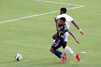 CARY, NC - AUGUST 01: DJ Taylor #27 knocks Brian Wright #7 off of the ball during a game between Birmingham Legion FC and North Carolina FC at Sahlen's Stadium at WakeMed Soccer Park on August 01, 2020 in Cary, North Carolina.