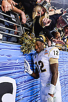 January 01, 2014:<br /> <br /> UCF Knights defensive back Jacoby Glenn #12 celebrates with fans at University of Phoenix Stadium in Scottsdale, AZ. UCF defeat Baylor 52-42 to claim it's first ever BCS Bowl trophy.