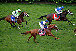 LOUISVILLE, KY - MAY 07: Cash Control #3 (L), ridden by Shaun Bridgmohan, Zipessa #8 (C), ridden by Florent Geroux, and Tepin #1 (R), ridden by Julien Leparoux, pass the grandstands for the first time during the Churchill Distaff Turf Mile on May 7, 2016 in Louisville, Kentucky. Tepin #1, ridden by Julien Leparoux, won the race. (Photo by Jon Durr/Eclipse Sportswire/Getty Images)