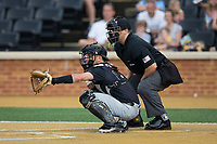 Wake Forest Demon Deacons catcher Logan Harvey (15) sets a target as home plate umpire Ryan Morehead looks on during the game against the West Virginia Mountaineers in Game Six of the Winston-Salem Regional in the 2017 College World Series at David F. Couch Ballpark on June 4, 2017 in Winston-Salem, North Carolina.  The Demon Deacons defeated the Mountaineers 12-8.  (Brian Westerholt/Four Seam Images)