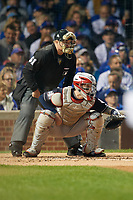Umpire Marvin Hudson and Cleveland Indians Roberto Perez (55) in the first inning during Game 4 of the Major League Baseball World Series against the Chicago Cubs on October 29, 2016 at Wrigley Field in Chicago, Illinois.  (Mike Janes/Four Seam Images)