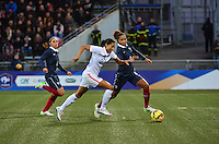 Lorient, France. - Sunday, February 8, 2015: Christen Press (23) of the USWNT vs Laura Georges (4) of France. USWNT vs France during an international friendly at the Stade du Moustoir.
