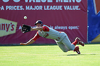 Williamsport Crosscutters outfielder Chase Harris (15) makes a diving catch during a game against the Batavia Muckdogs on July 27, 2014 at Dwyer Stadium in Batavia, New York.  Batavia defeated Williamsport 6-5.  (Mike Janes/Four Seam Images)