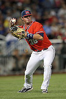 John Gatlin #36 of the Ole Miss Rebels throws during Game 4 of the 2014 Men's College World Series between the Virginia Cavaliers and Ole Miss Rebels at TD Ameritrade Park on June 15, 2014 in Omaha, Nebraska. (Brace Hemmelgarn/Four Seam Images)