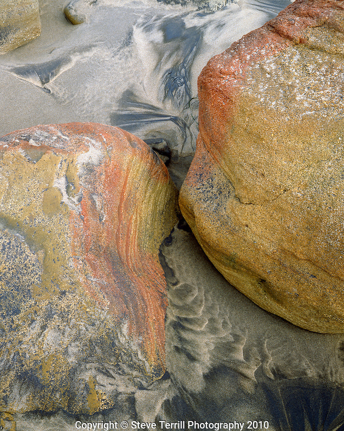 Sandstone boulders on beach at Hug Point State Park, Oregon
