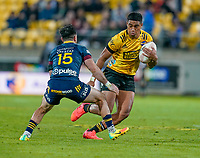 30th April 2021; Wellington, New Zealand;  Hurricanes Salesi Rayasi tries to evade the tackle.  Hurricanes versus  Highlanders, Super Rugby, Sky Stadium, Wellington New Zealand, Friday 30 April 2021.