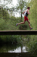 10 MAY 2015 - ST. NEOTS, GBR - A competitor crosses a bridge during the 2015 British Sprint Triathlon Championships in Riverside Park in St. Neots, Great Britain (PHOTO COPYRIGHT © 2015 NIGEL FARROW, ALL RIGHTS RESERVED)