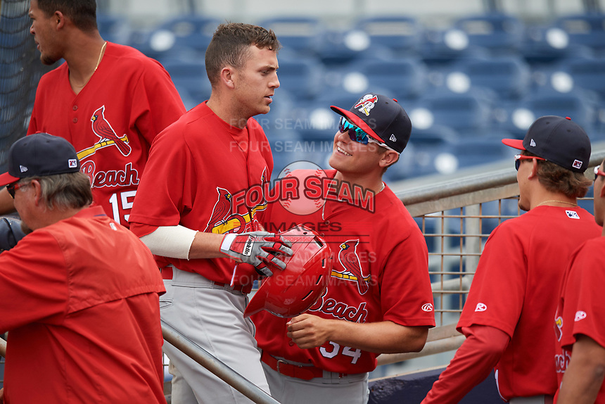 Palm Beach Cardinals designated hitter Luke Dykstra (32) is greeted by Connor Jones (34) after hitting a home run during a game against the Charlotte Stone Crabs on April 12, 2017 at Charlotte Sports Park in Port Charlotte, Florida.  Palm Beach defeated Charlotte 8-7 in ten innings.  (Mike Janes/Four Seam Images)