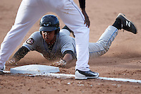 Hudson Valley Renegades catcher Jose Rojas (5) slides head first into third during a game against the Batavia Muckdogs on July 31, 2016 at Dwyer Stadium in Batavia, New York.  Hudson Valley defeated Batavia 4-1.  (Mike Janes/Four Seam Images)