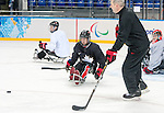 Sochi, RUSSIA - Mar 2 2014 -  Adam Dixon and Assistant Coach Curtis Hunt during practice before the 2014 Paralympics in Sochi, Russia.  (Photo: Matthew Murnaghan/Canadian Paralympic Committee)