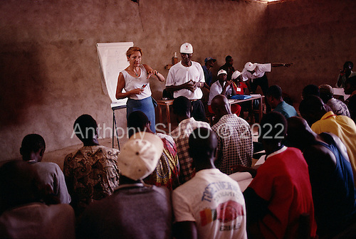 Kouloumba, Guinea<br /> April 2001<br /> <br /> Kouloumba refugee camp in Guinea. Jacqueline, the director of Guinea's child protection and reunification program for IRC/UAM, speaks to the camp's community leaders about protecting women and children when moving from one camp to the other.