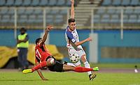 Couva, Trinidad & Tobago - Tuesday Oct. 10, 2017: Jorge Villafaña, Alvin Jones during a 2018 FIFA World Cup Qualifier between the men's national teams of the United States (USA) and Trinidad & Tobago (TRI) at Ato Boldon Stadium.