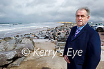 Cllr: Michael Cahill standing on Rossbeigh beach highlighting issues with trouble being caused by illegal parking by Travellers every year.