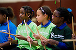 "WATERBURY, CT- 20 November 2014-112014EC01--   Alexus Lowe, Alana Johnson and Alexiandria Richards (L to R) play ""Bucket Bash,"" a drum performance, as part of the Fall Showcase from members of the Waterbury Symphony's Bravo Waterbury! music program. Hundreds came out to hear the concert in Sacred Heart's gymnasium Thursday night. Erin Covey Republican-American"