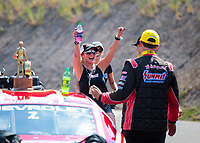 Jul 21, 2019; Morrison, CO, USA; NHRA pro stock driver Greg Anderson celebrates with wife Kim Anderson after winning the Mile High Nationals at Bandimere Speedway. Mandatory Credit: Mark J. Rebilas-USA TODAY Sports