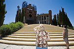 A couple of unidentified tourist have a look on Don Justo´s Cathedral in Mejorada del Campo, Spain - Don Justo Gallego Martínez, a former seminarist who has been building his own cathedral without formal plans and no church support in order to be dedicated to Nuestra Señora del Pilar. By using recycled elements and inspired in the way old castles has been built, he has been working mainly alone in this task. He is currently 85 years old.