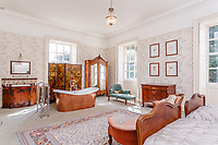 BNPS.co.uk (01202) 558833. <br /> Pic: Strutt&Parker/BNPS<br /> <br /> Pictured: Bedroom with bath. <br /> <br /> A grand Georgian manor where writer Evelyn Waugh lived and died is on the market for £5.5m.<br /> <br /> The author of Vile Bodies, Brideshead Revisited and Sword of Honour bought Combe Florey House in Somerset in 1956 and his family lived there until 2008 when they sold it to the current owners.<br /> <br /> In Waugh's day the house was often filled with his glamorous and clever guests like poet John Betjeman, actors Peter Cook and Alec Guinness and writers Salman Rushdie and Muriel Spark.<br /> <br /> The 12-bedroom house has had a makeover since Waugh's day and quirky style and is now a light-filled spacious family home with a party barn, swimming pool and 34 acres.