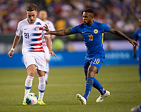 PHILADELPHIA, PA - JUNE 30: Tyler Boyd #21 is challenged by Leandro Bacuna #10 during a game between Curacao and USMNT at Lincoln Financial Field on June 30, 2019 in Philadelphia, Pennsylvania.