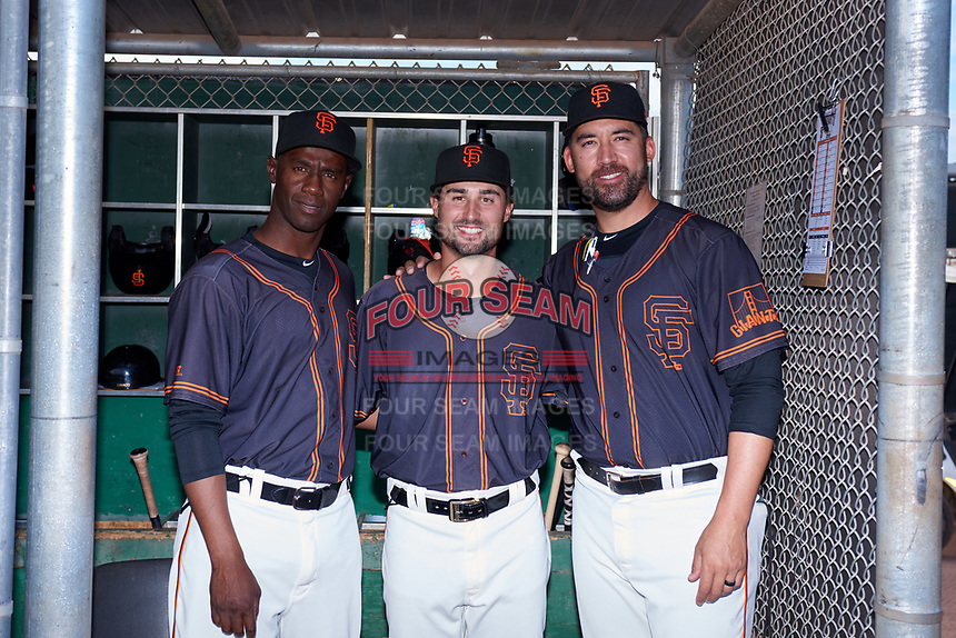 AZL Giants Black coaches Juan Ciriaco, Michael Johnson, and Travis Ishikawa pose for a photo before an Arizona League game against the AZL Giants Orange on July 19, 2019 at the San Francisco Giants Baseball Complex in Scottsdale, Arizona. The AZL Giants Black defeated the AZL Giants Orange 8-5. (Zachary Lucy/Four Seam Images)
