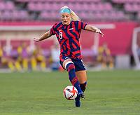 KASHIMA, JAPAN - AUGUST 5: Julie Ertz #8 of the USWNT dribbles during a game between Australia and USWNT at Kashima Soccer Stadium on August 5, 2021 in Kashima, Japan.