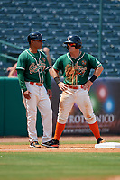 Greensboro Grasshoppers manager Angel Espada (1) talks with designated hitter Cameron Baranek (7) during a game against the Lakewood BlueClaws on June 10, 2018 at First National Bank Field in Greensboro, North Carolina.  Lakewood defeated Greensboro 2-0.  (Mike Janes/Four Seam Images)