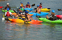 Young kayakers learns the skill of whitewater kayaking while participating in a summer camp program at the US National Whitewater Center (USNWC) in Charlotte, NC.