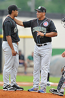 David Rosario #16 pitching coach of the Kane County Cougars talks to pitcher Duane Underwood against the Clinton LumberKings at Ashford University Field on July 5, 2014 in Clinton, Iowa. The Cougars won 4-0.   (Dennis Hubbard/Four Seam Images)
