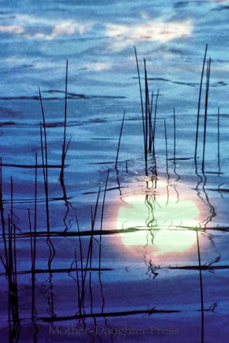 Sunset reflected in lake, Missouri USA