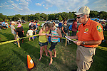 CCSO Search and Rescue member Matt Medeiros watches as Mary Frayo, 10, left, and Jazmin Estes, 11, work their way through the compas course at the 11th annual National Night Out hosted by the Carson City Sheriff's Office in Carson City, Nev., on Tuesday, Aug. 6, 2013. <br />