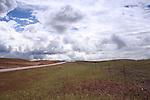 Montana 141 rolls across open range land under threatening skies.