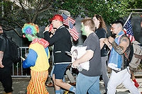 """Alt-right provocateur Milo Yiannopoulos walks with supporters after serving as Grand Marshall of the Straight Pride Parade in Boston, Massachusetts, on Sat., August 31, 2019. Yiannopoulos wore a sequined red hat in the style of Make America Great Again (MAGA) hats reading """"Make America Straight Again."""" Yiannopoulos addressed the crowd with a short speech on arrival and then rode the """"Trump Unity Bridge"""" float for the duration of the parade. Despite leading the Straight Pride Parade and singing along with patriotic American songs throughout the parade, Yiannopoulos is gay and is not an American citizen."""