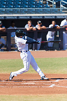 Peoria Javelinas first baseman Evan White (15), of the Seattle Mariners organization, swings at a pitch during an Arizona Fall League game against the Glendale Desert Dogs at Peoria Sports Complex on October 22, 2018 in Peoria, Arizona. Glendale defeated Peoria 6-2. (Zachary Lucy/Four Seam Images)