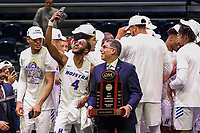 Washington, DC - March 10, 2020: Hofstra Pride guard Desure Buie (4) takes a selfie with CAA commisioner Joe D'Antonio after the CAA championship game between Hofstra and Northeastern at  Entertainment and Sports Arena in Washington, DC.   (Photo by Elliott Brown/Media Images International)