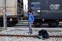 Pictured: A migrant man with his belongings at the OSE freight depot in Thessaloniki, Greece. Wednesday 05 April 2017<br /> Re: A year after an agreement was signed between Greece and Turkey for the management of refugees. Migrants, mostly from Morocco, Algeria and Tunisia, have been living in disused train carriages at the Thessaloniki freight depot of OSE in northern Greece, the company managing the railways in the country. Some of the migrants climb onto moving trains, or even hide themselves in storage areas, hoping that they will cross the border.